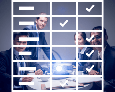 Image shows business team watching comparison chart presentation